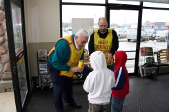 "The ""Tootsie Roll Man,"" John Clark hands out treats as part of a Knights of Columbus fund-raiser."