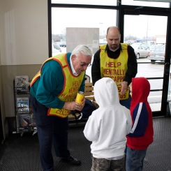 "The ""Tootsie Roll Man,"" John Clark hands out treats as part of a Knights of Columbus fund-raiser."