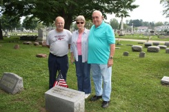 Curt Pippinger, Sandy Clark and John Clark at Calvary Cemetery.