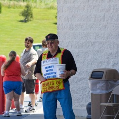 John collects donations for Knights of Columbus charities.