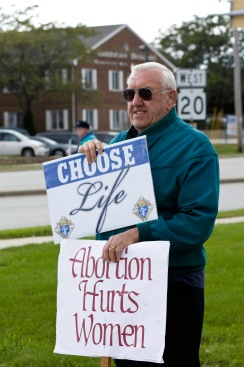 True to the K of C emphasis on the dignity of life, John holds signs at the annual Respect Life Month rally.