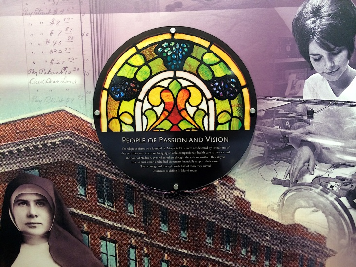 A portion of the stained glass detail is used in a history display in the old lobby of St. Mary's Hospital in Madison, Wis.