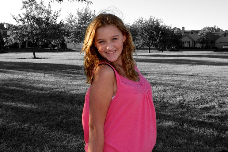 Daughter Ruby at the park near our home. The color pink works very well as a color splash.