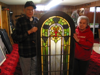 David and Mary Hanneman with a section of stained glass window on the day the windows were picked up for use at St. Mary's Hospital.
