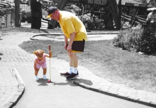 Playing mini-golf with my daughter Ruby in 1999.