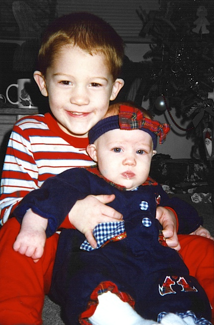 My son Stevie holding his sister Samantha at Christmas 1996. There was not much exciting in the background, so this effect makes the faces really stand out.